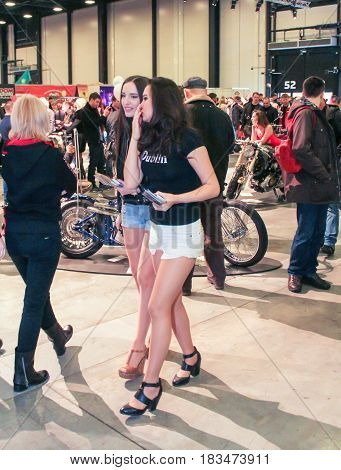 St. Petersburg Russia - 15 April, Girls are distributors among people,15 April, 2017. International Motor Show IMIS-2017 in Expoforurum. Visitors and participants of the annual moto-salon in St. Petersburg.