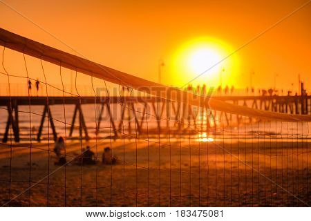 Glenelg beach at sunset viewed across valleyball net South Australia