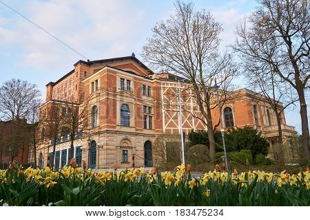 Wagner Festival Theatre in Bayreuth at daylight near sunset - side view. poster