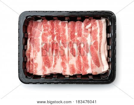 Top view of plastic disposable tray with raw sliced bacon isolated on white