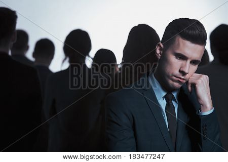 Businessman And Anonymous Crowd