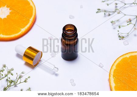 Branding Mock-up. Natural Essential Oil, Cosmetic Bottle Containers With Orange Slices.