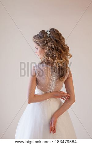 spin the bride in a wedding dress in a white room 1
