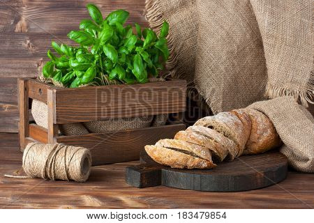 Freshly baked traditional ciabatta bread on wooden board
