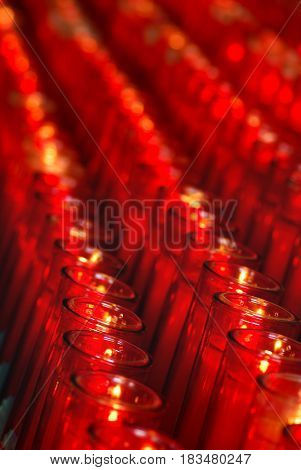 Background image of candles, red candles in rows