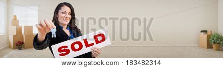 Banner of Hispanic Woman Inside Room with Boxes Holding House Keys and Sold For Sale Real Estate Sign.