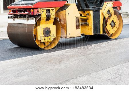 Road Roller At Work. Work Of Asphalting A Road.