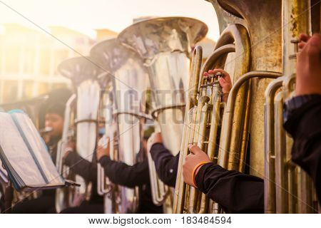 Musician playing tuba in street orchestra / cinematic tone / Made from light photo graphic / soft focus