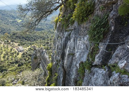Climbing metal cables hitched on rock for via ferratas on background of beautiful landscape