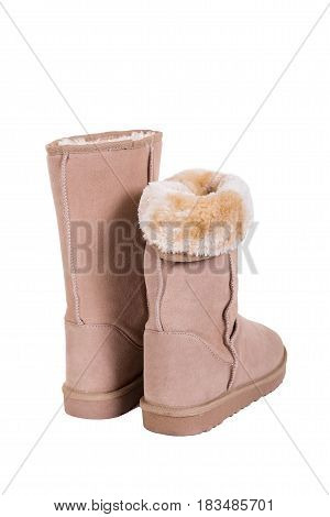 Fashion winter ugg boots of sheepskin isolated on white backgrou.