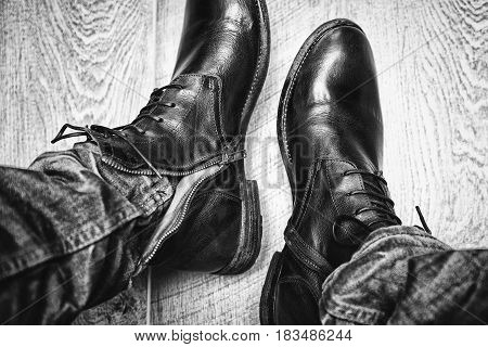 Mens leather shoes close-up, jeans. men's clothing