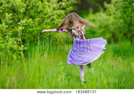 little girl dancing outdoor beautiful long hair