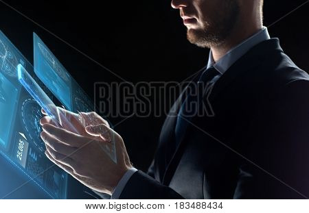 business, people and future technology concept - close up of businessman with transparent tablet pc computer and virtual screen projection over black background