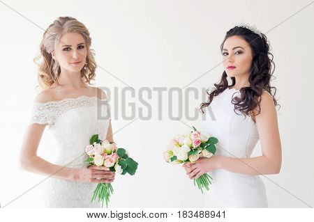 two wedding bride with bouquet wedding hairstyle