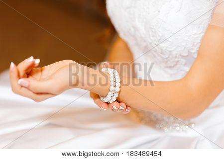 jeweler bracelet on the bride's hand wedding