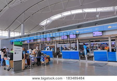 HO CHI MINH CITY VIETNAM - DECEMBER 2, 2016: Unidentified people check in at Vietnam Airline check in counter at Ho chi Minh City International airport.