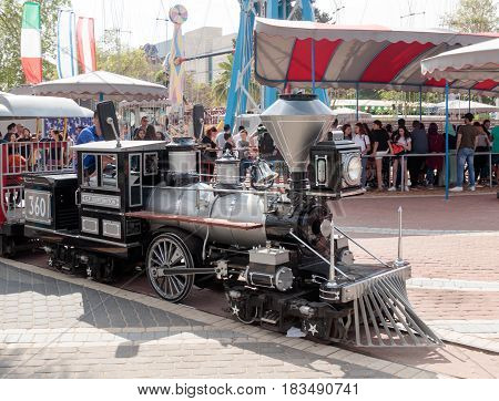 Tel Aviv Israel April 16 2016 : Reduced copy of the locomotive drives around the amusement park run by a young man in Tel Aviv Israel