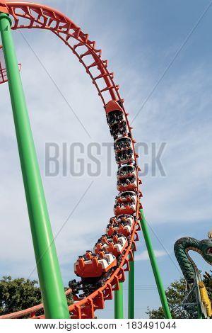 Tel Aviv Israel April 16 2016 : Visitors to the city's attractions park ride on the roller coaster in Tel Aviv Israel