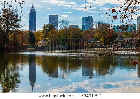 View of Lake Clara Meer bridge with gazebo and Midtown Atlanta in sunny autumn day USA