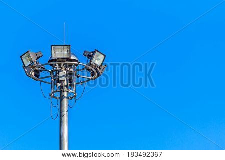 Halogen spotlights and blue sky background for design.