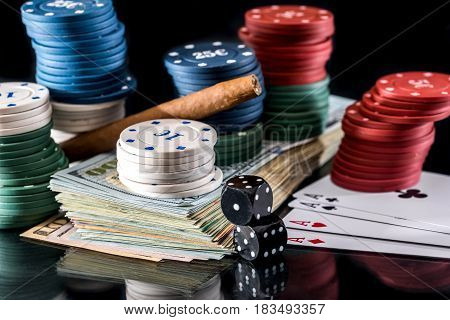 poker combinations - chips money and card isolated on black