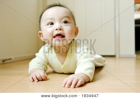 Baby Boy Crawling On Floor