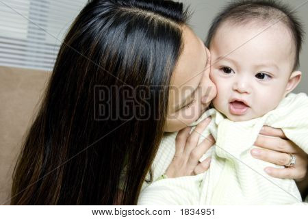 Mother Embracing Baby Son (6-9 Months)