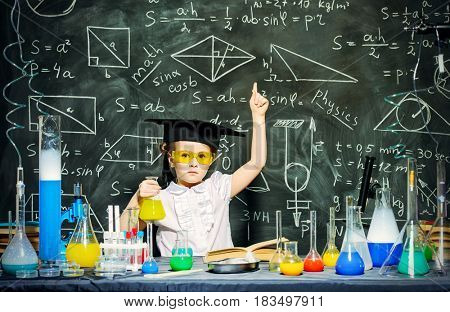 Cute little girl scientist making experiments in the laboratory. Educational concept. Early development of children.