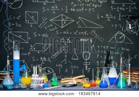 Scientific laboratory background. Chemical equipment: test tubes, beakers, flasks. Education.