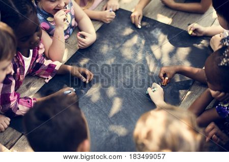 Group of children with blank blackboard