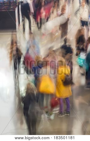 Abstract people walking in exhibition - trade fair show, Abstract defocused motion blurred young people walking in the shopping center. For background , backdrop, substrate, composition use.