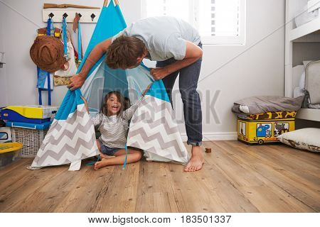 Father And Daughter Playing In Wigwam In Playroom