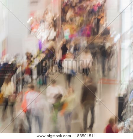 Abstract blurred image of shopping mall, people, exhibition - trade fair show. For background , backdrop, substrate, composition use.