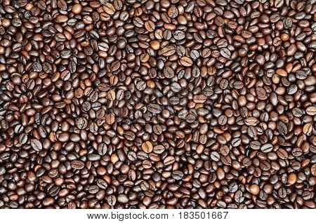 Background Texture Of A Huge Number Of Fragrant And Fresh Brown Roasted Coffee Grains