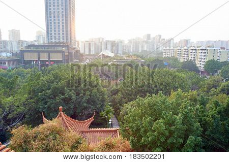 SHENZHEN, CHINA - MARCH 01, 2016: view of Longgang District from the park in the daytime. Longgang District is one of the six districts of Shenzhen, China.