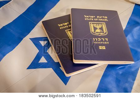 State of Israel passport with the flag of Israel on the background illustrative image.