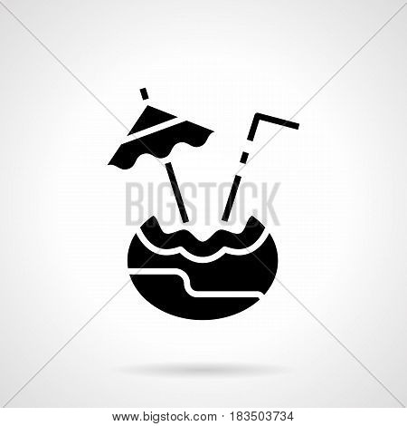 Abstract monochrome symbol of coconut with drink, umbrella and straw. Exotic beverages menu. Symbolic black glyph style vector icon.