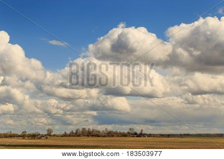 Field Against The Sky With Clouds In The Spring