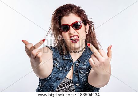 Plus sized modelwith two fingers up, representing defiance on white background.