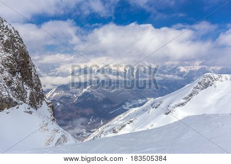 Scenery top view on winter mountains from ski resort Gorky Gorod