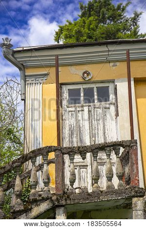 View on old abandoned house at summer day