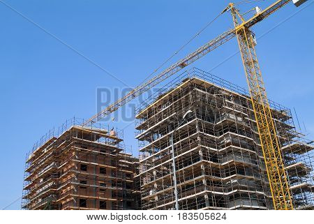 Residential Construction site with scaffolding and crane