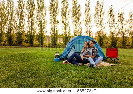 Shot of a happy couple camping on the nature