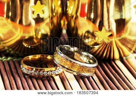 Two gold wedding rings with reflections brilliant luxury happy