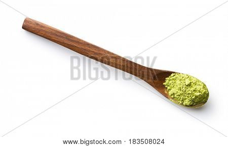 Green matcha tea powder in spoon isolated on white background.