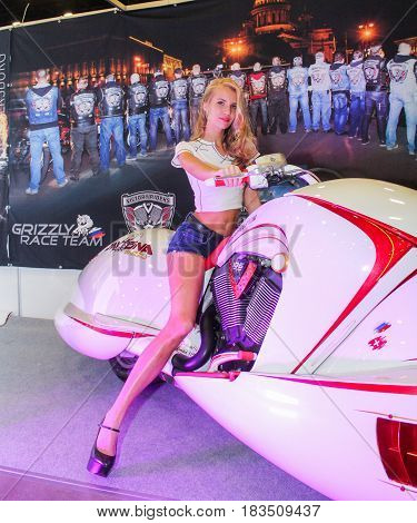 St. Petersburg Russia - 15 April, Girl driving a motorcycle,15 April, 2017. International Motor Show IMIS-2017 in Expoforurum. Models on motorcycles presented at the motor show.