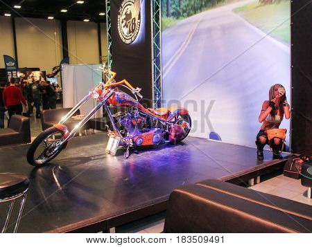 St. Petersburg Russia - 15 April, Motobike and model corrective makeup,15 April, 2017. International Motor Show IMIS-2017 in Expoforurum. Models on motorcycles presented at the motor show.