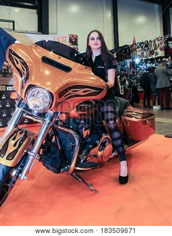 St. Petersburg Russia - 15 April, Girl on a motorcycle,15 April, 2017. International Motor Show IMIS-2017 in Expoforurum. Models on motorcycles presented at the motor show.