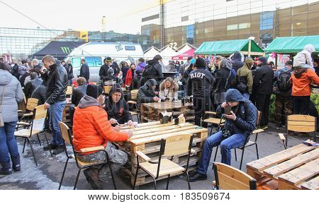 St. Petersburg Russia - 15 April, Improvised dining room on the street,15 April, 2017. International Motor Show IMIS-2017 in Expoforurum. Visitors to a motor show in an improvised street food station.