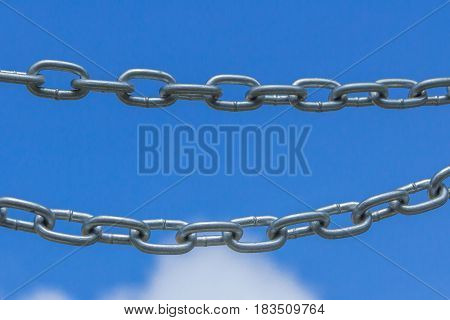 Chains on a blue sky background link concept